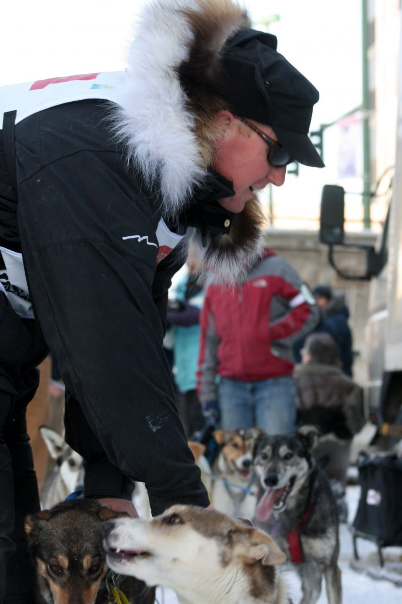 Kris Hoffman gets his dogs ready during the ceremonial start through Anchorage on Saturday. Hoffman will be racing in his first Iditarod race, which starts today.