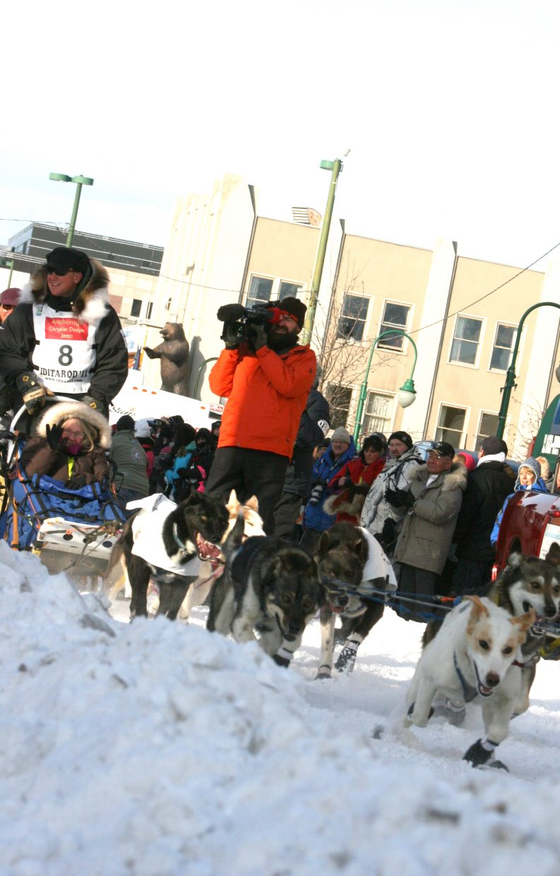 Kris Hoffman participates in the ceremonial start down the streets of Anchorage, Alaska, in preparation for the Iditarod, which begins today.