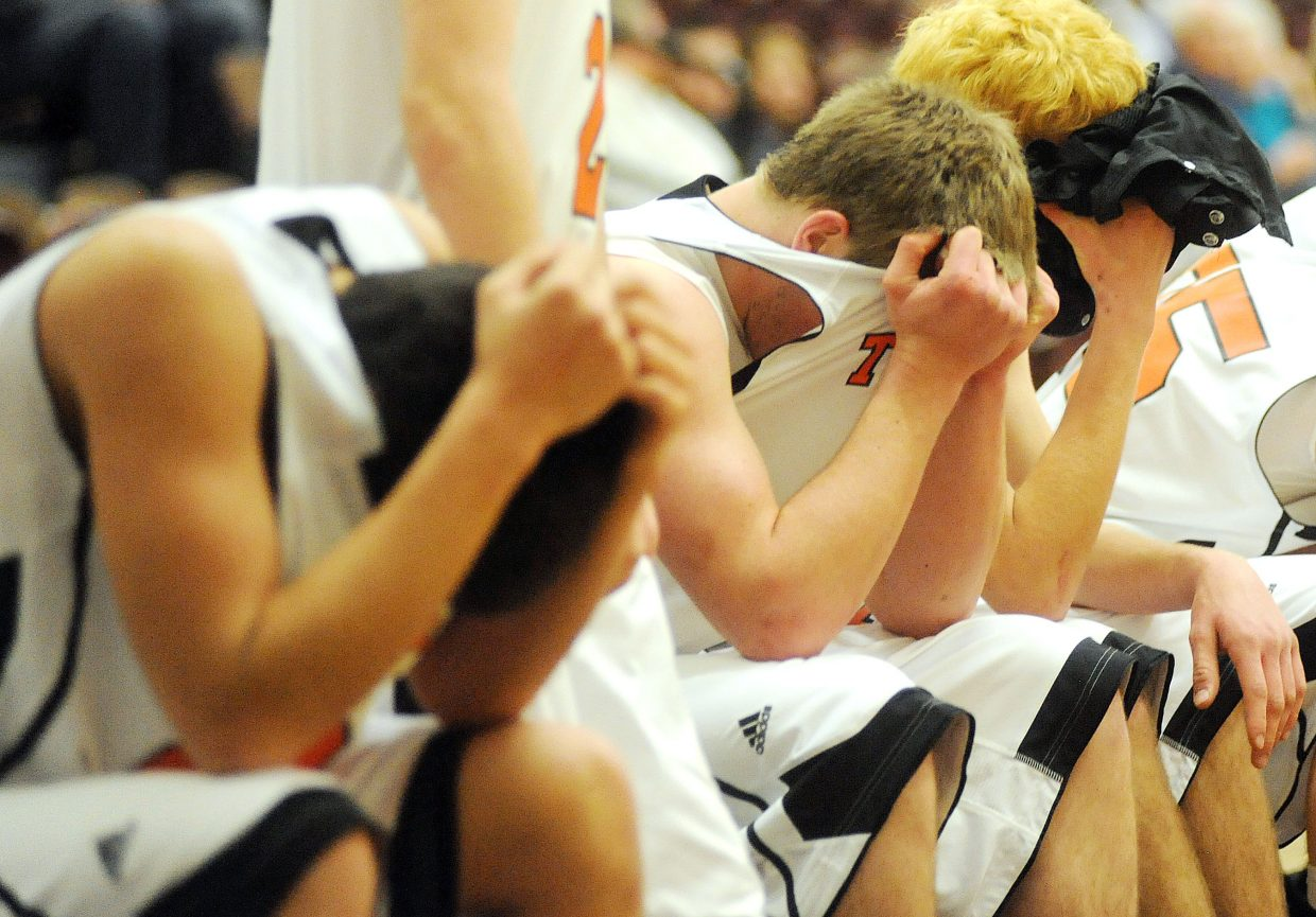 Members of the Hayden High School boys basketball team show their disappointment Saturday after falling to Denver Christian in the regional championship basketball game in Grand Junction. Hayden lost, 64-39.