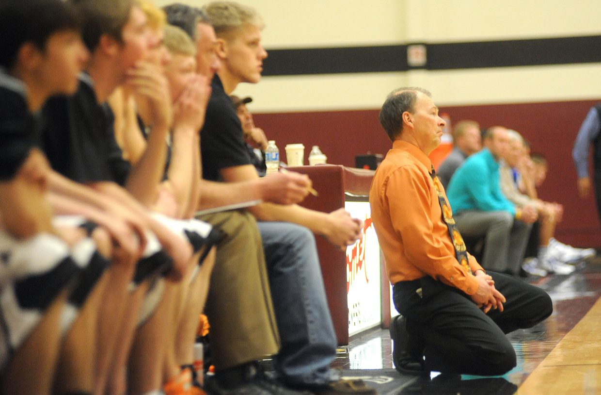 Hayden coach Mike Luppes falls to his knees after a play goes against the Tigers on Saturday in the regional championship game in Grand Junction. Hayden lost the game, which ended the Tigers' season.