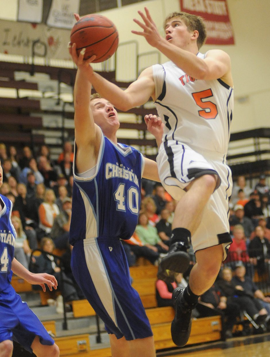 Hayden's Ben Williams goes up for a layup on Saturday in the regional championship game in Grand Junction.