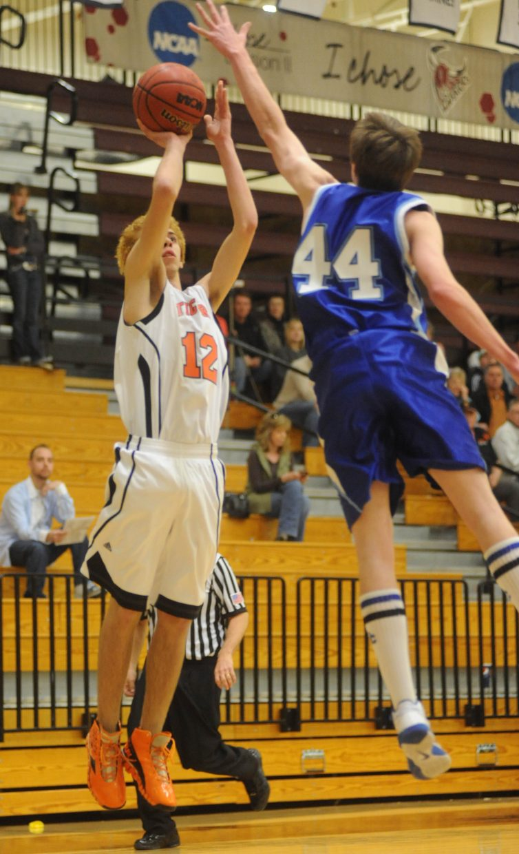 Hayden's Brandon Ray tries to get a shot off Saturday in the regional championship game in Grand Junction.
