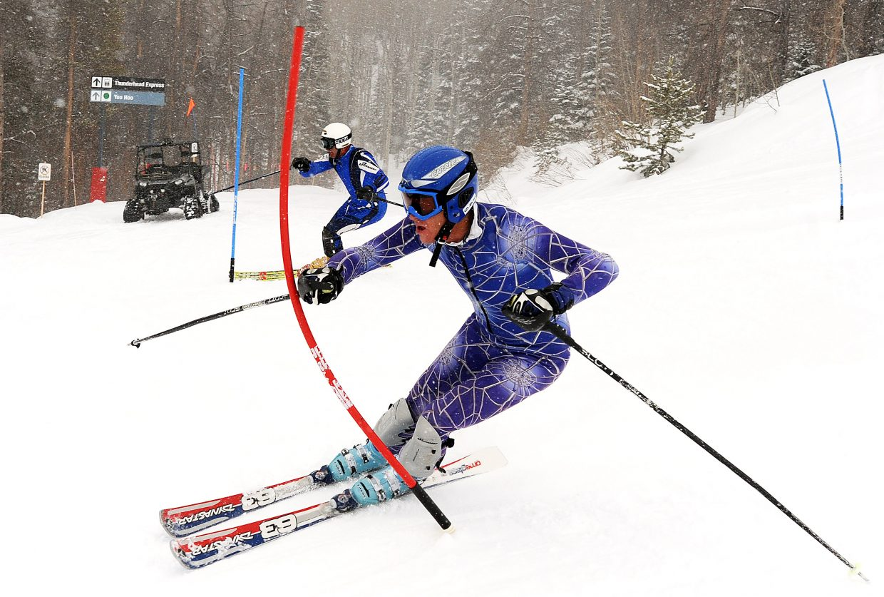 Lindsay Wert, foreground, and Stephan Zittel race down a slalom course at Steamboat Ski Area on Sunday during the final run of the Town Challenge Dick Haller Memorial race. The event stretched two days and challenged skiers with two giant slalom runs Saturday and two slalom runs Sunday. Trevyn Newpher emerged atop the men's standings, ahead of Michael Bobela and Tim Magill. Valerie Powell was the fastest woman, ahead of Emily Serrell and Diana Childs.
