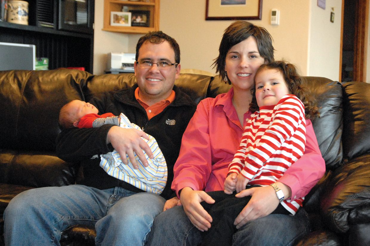 Dana Duran sits with her husband, Ryan, daughter Haley and newborn son Carter at the family's home in Craig. Duran said she loves to be outdoors with her family when she's not working, going cross-country skiing, biking, hiking or walking.