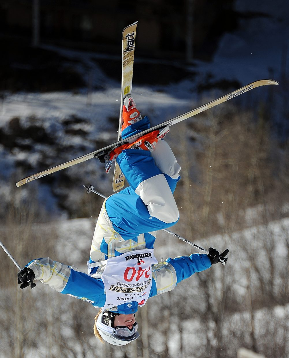 Ali Kariotis flips off the bottom kicker during the moguls event at the Freestyle Junior Nationals in Steamboat Springs on Friday. She won the women's event.
