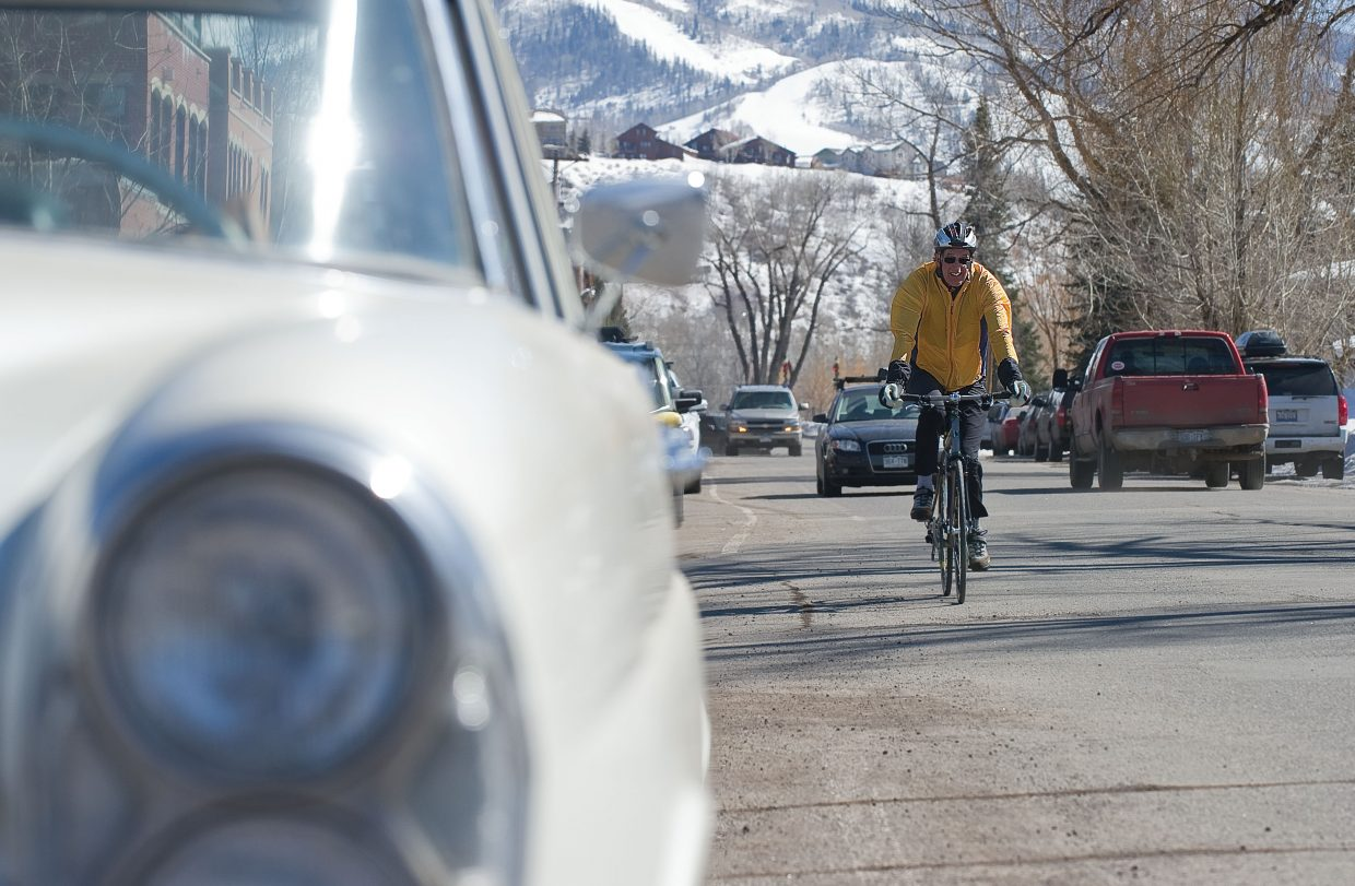 Jim Weishaar rides his bike along Yampa Street in Steamboat Springs. The revitalization of Yampa Street will be a hot topic in upcoming weeks. City staff will make two presentations at the March 20 Steamboat Springs City Council meeting, and Mainstreet Steamboat Springs is hosting a meeting of Yampa Street stakeholders March 27.