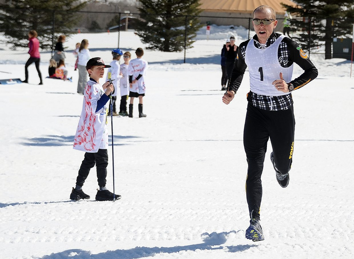 Steamboat's Barkley Robinson runs to the finish of the Steamboat Pentathlon. Robinson was a loyal participant of the Steamboat Pentathlon, which will end its course after 27 years. (Photo by: Joel Reichenberger)