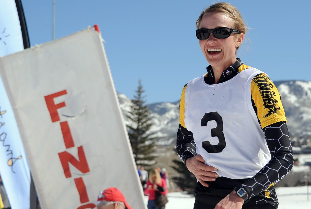 Hannah Williams crosses the finish line with a smile Saturday after winning the Steamboat Pentathlon for the second consecutive year.