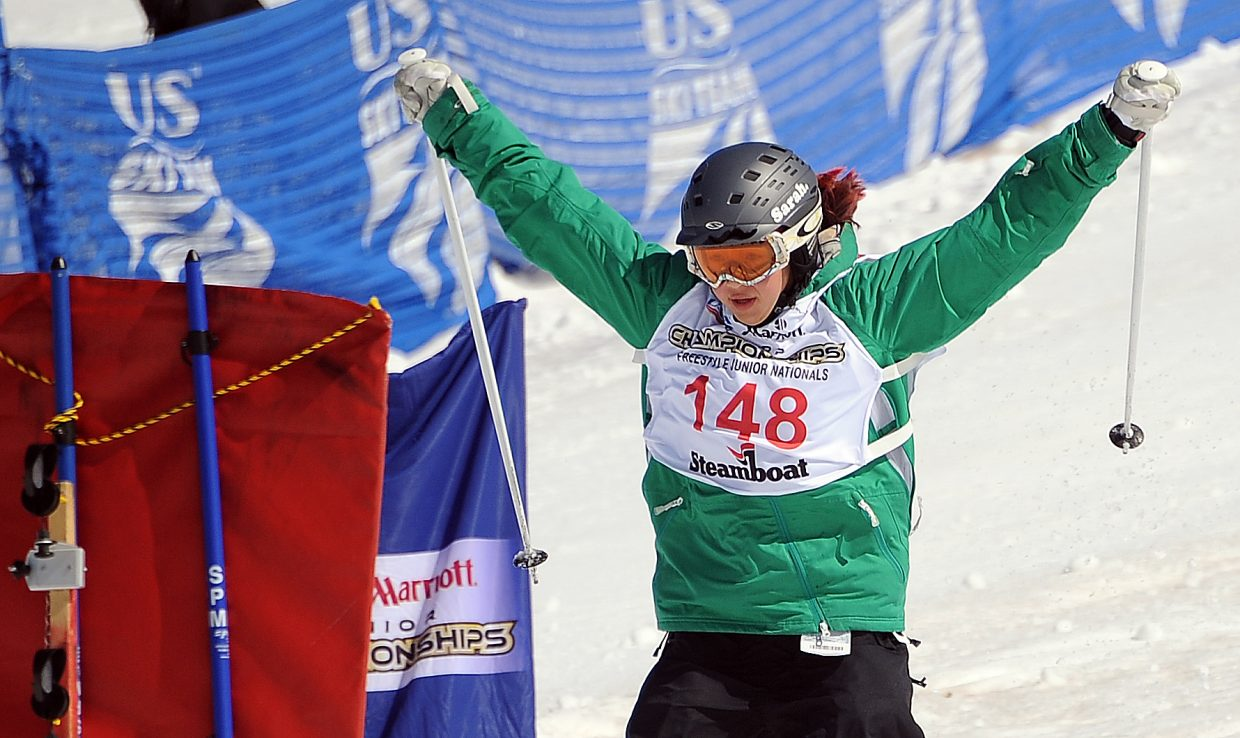 Anna Park celebrates as she crosses the finish line Sunday at the dual moguls event at Freestyle Junior Nationals in Steamboat Springs.
