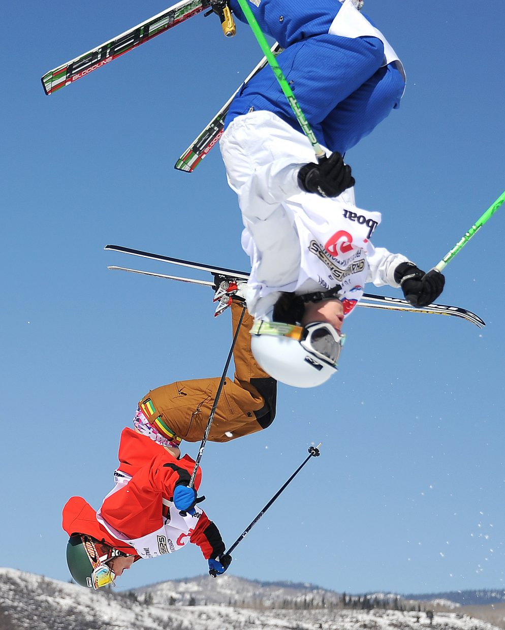 Avital Shimko, bottom, eyes her landing during a trick at the dual moguls event at Freestyle Junior Nationals in Steamboat Springs. Shimko, a Steamboat skier, finished fourth.