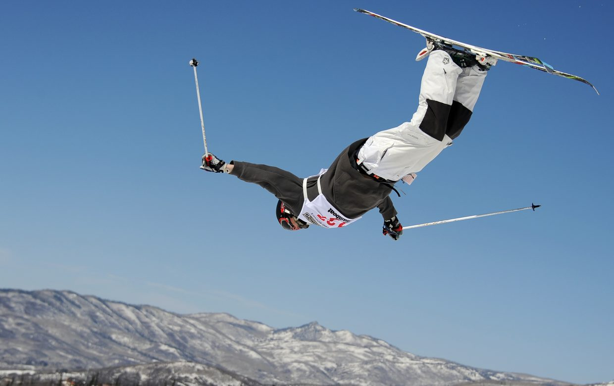 Blake Wilson flies high above Steamboat Springs on Sunday during the Freestyle Junior Nationals dual moguls event.