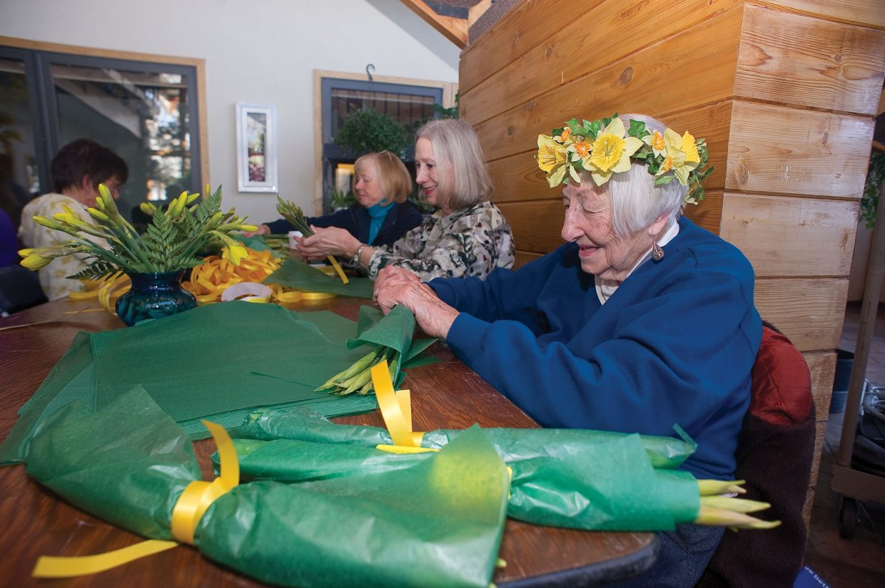 Volunteer Jean Davidson wraps daffodils Monday morning at Alpine Floral & Atrium in Steamboat Springs. Bunches of daffodils can be purchased from the Northwest Colorado Visiting Nurse Association, Alpine Floral, and Ace at the Curve, Hayden Mercantile, Bonfiglio Drug, The Clark Store, as well as the City Market and Safeway stores in Steamboat Springs and Craig from Heralds of Hope volunteers.