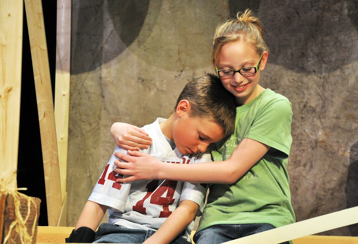 "Liam Frentress, left, plays the role of Wilbur the pig during a rehearsal of ""Charlotte's Web"" on Tuesday as he is consoled by Hannah Wilkie, who plays the role of Fern."