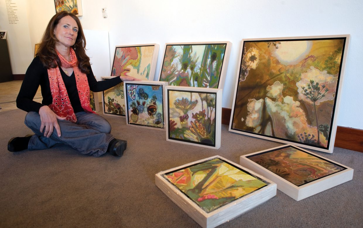 Diane Cionni discusses her mixed media artwork at RED Contemporary on Tuesday, where she will be featured through the end of the ski season. Cionni paints naturescapes with influences from contemplative traditions.