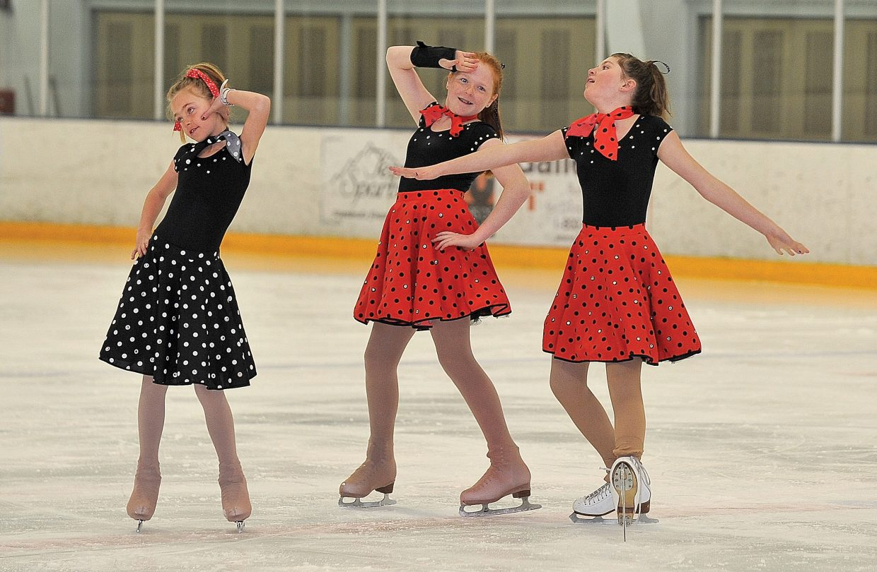 """Steamboat Springs Figure Skating Club members, from left, Alison Famulare, Mariah Walker and Sage Turek wrap up their performance of """"You Can't Stop the Beat"""" during a rehearsal for the """"Broadway on Ice"""" spring ice show. The show will take place at 7 p.m. today and Saturday at Howelsen Ice Arena."""