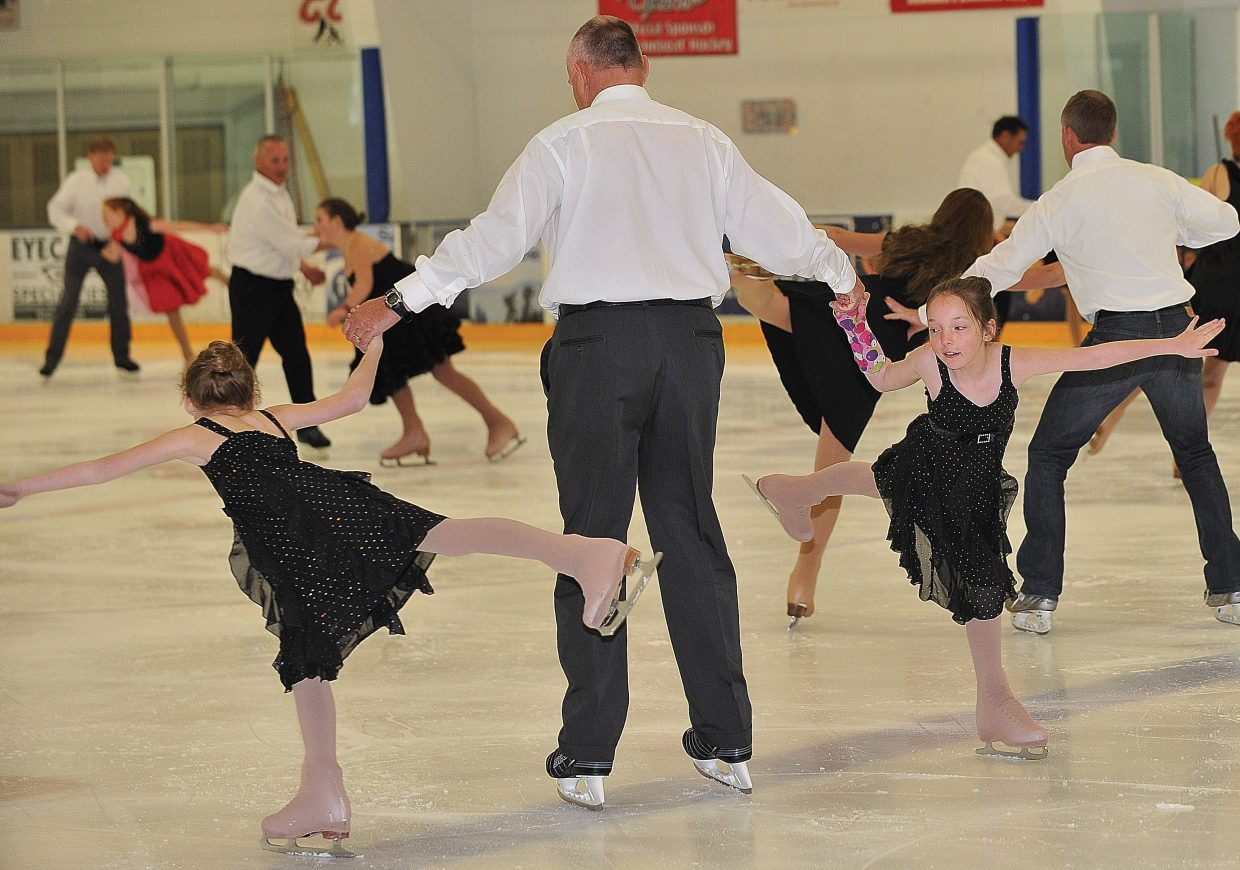 """Mike Curzon gets spun around the ice by family friend Soren Brockway, left, and his daughter Natasha Curzon while rehearsing a father-daughter act in the Steamboat Springs Figure Skating Club's """"Broadway on Ice"""" show."""