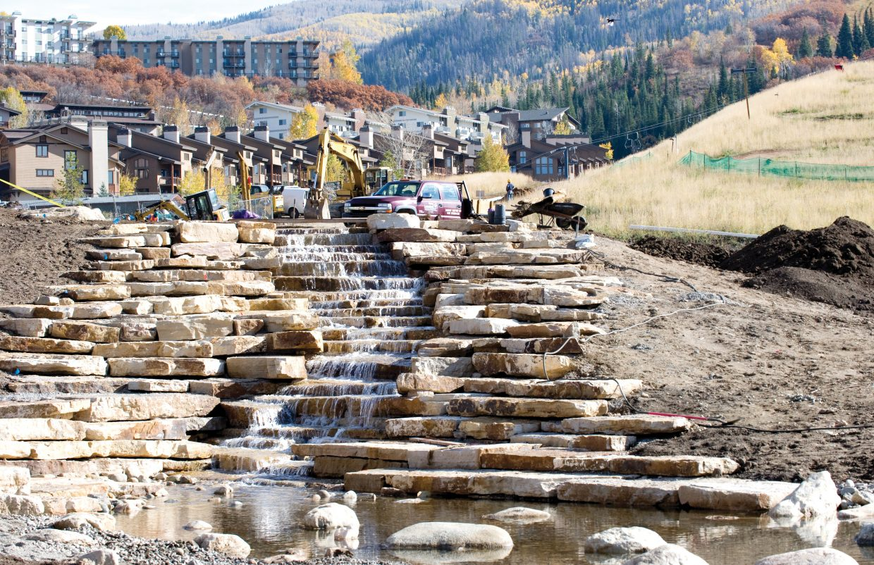 Construction crews work in October on a section of man-made waterfalls featured as part of the promenade at the base of Steamboat Ski Area. Sheraton Steamboat Resort and Steamboat Ski and Resort Corp. officials have said summer wedding and convention bookings are strong.