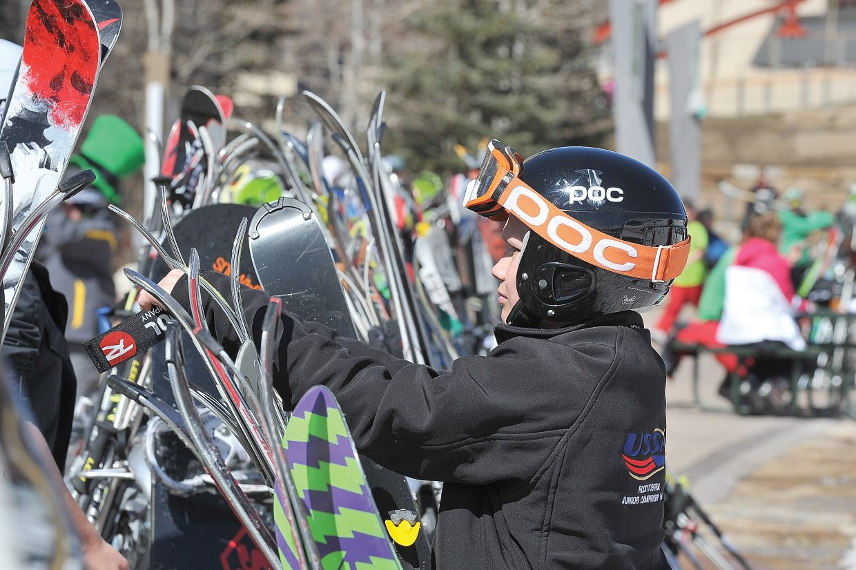 Brad Klinger, visiting from Michigan, puts his skis on a rack Friday afternoon at the base of Steamboat Ski Area.