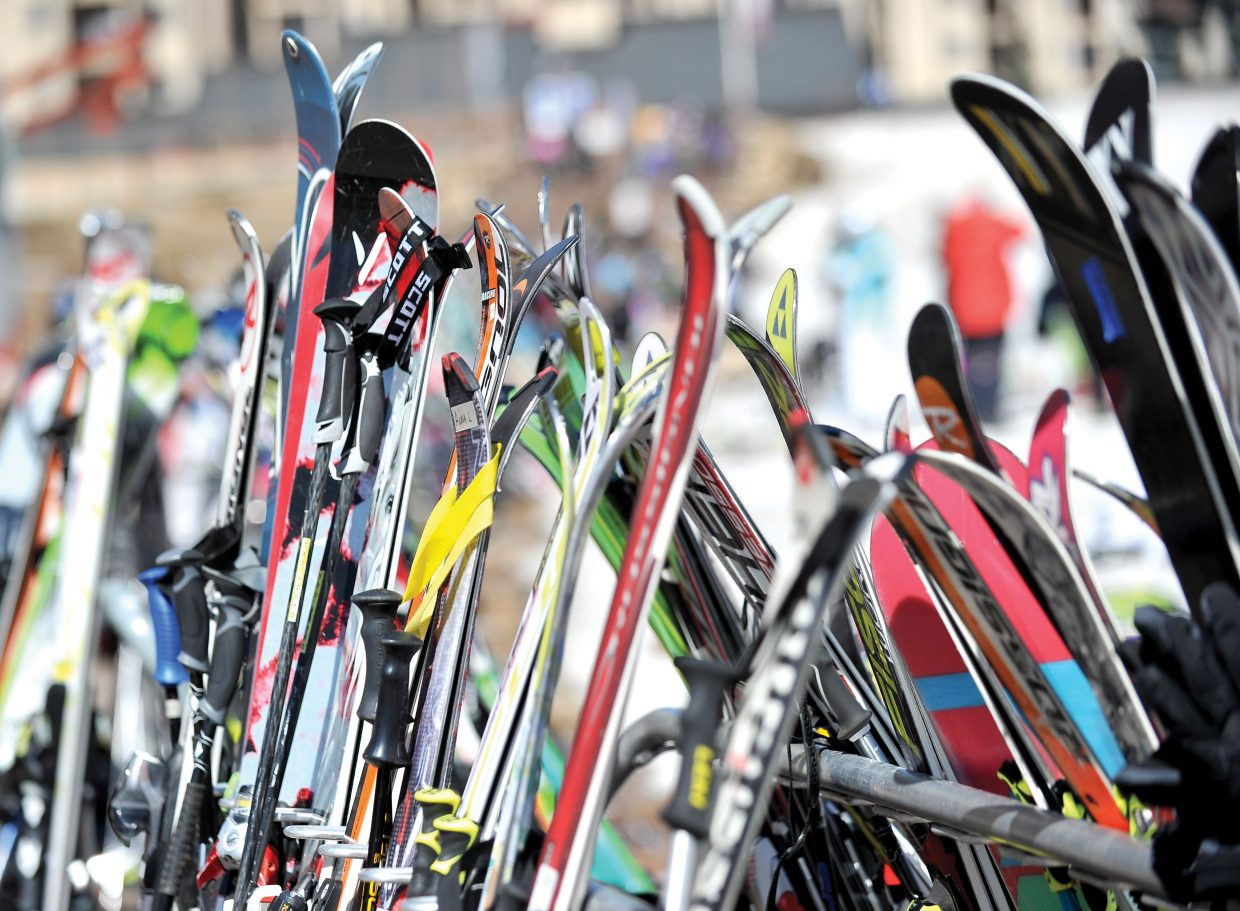 Skis line the racks at the base of the Steamboat Ski Area on Friday afternoon.