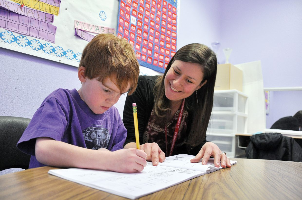 Diane Yazbeck encourages Daniel Keith on Thursday during his writing lesson at Strawberry Park Elementary School. Yazbeck, a special education teacher, is Steamboat's Teacher of the Year.