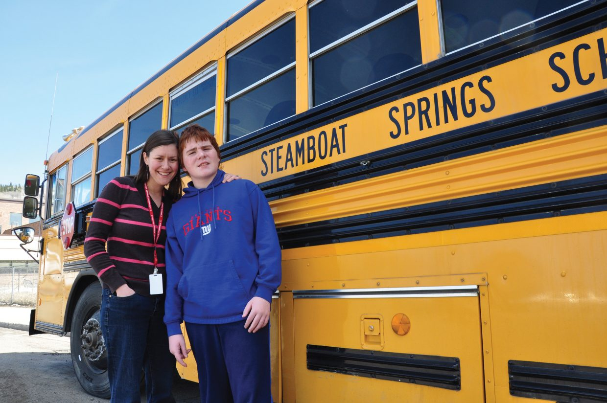 Diane Yazbeck poses with Jack English on Friday at Steamboat Springs Middle School. Diane started to teach Jack, who was diagnosed with autism as an infant, when he was 3 years old. The two continue to be close friends today. Yazbeck, a special education teacher, is Steamboat's Teacher of the Year.