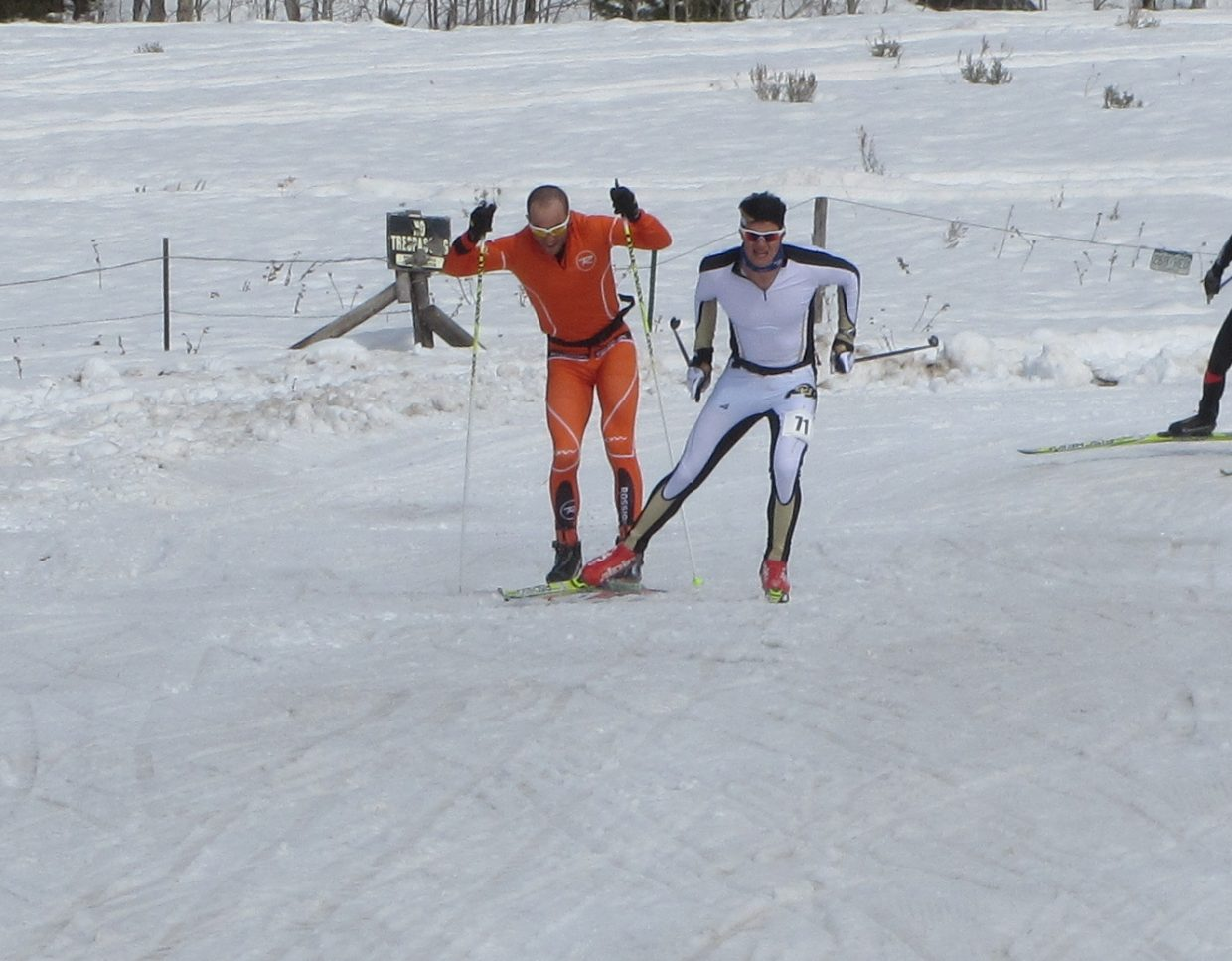 Rune Oedegaard, right, and Josh Smullin race toward the finish Saturday during the Glide the Divide 90-kilometer skate race.