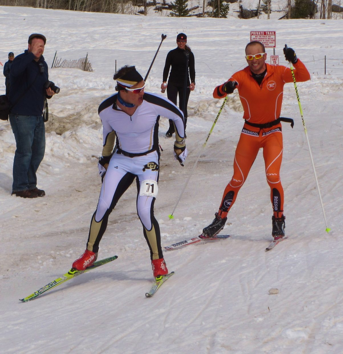 Rune Oedegaard, left, and Josh Smullin race toward the finish Saturday during the Glide the Divide 90-kilometer skate race.