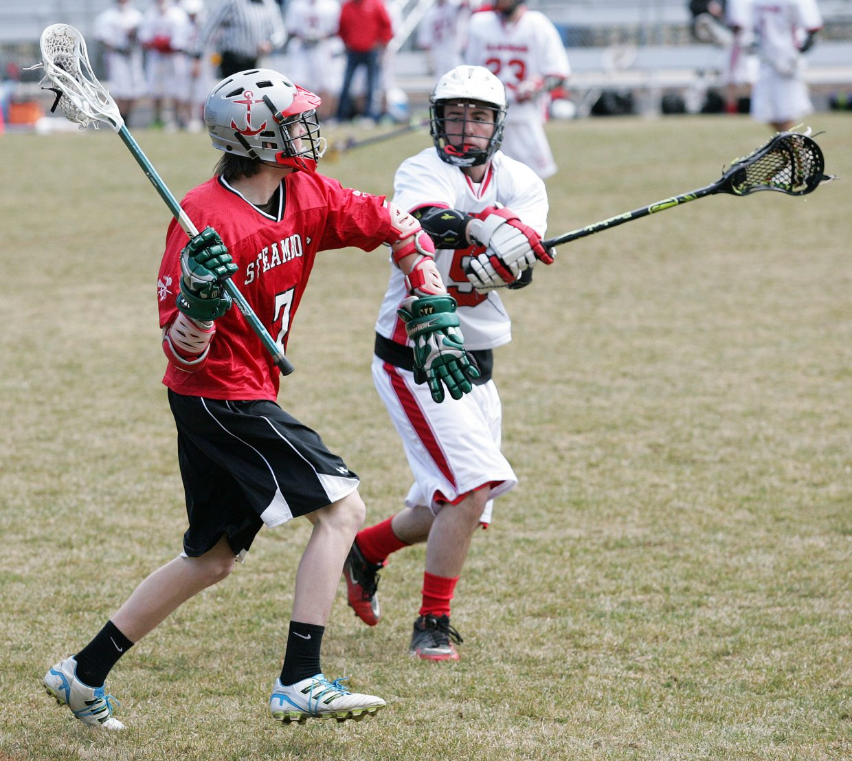 Steamboat Springs' Logan Banning looks to pass in the face of defensive pressure from Glenwood Springs' Jimmy Butcher.