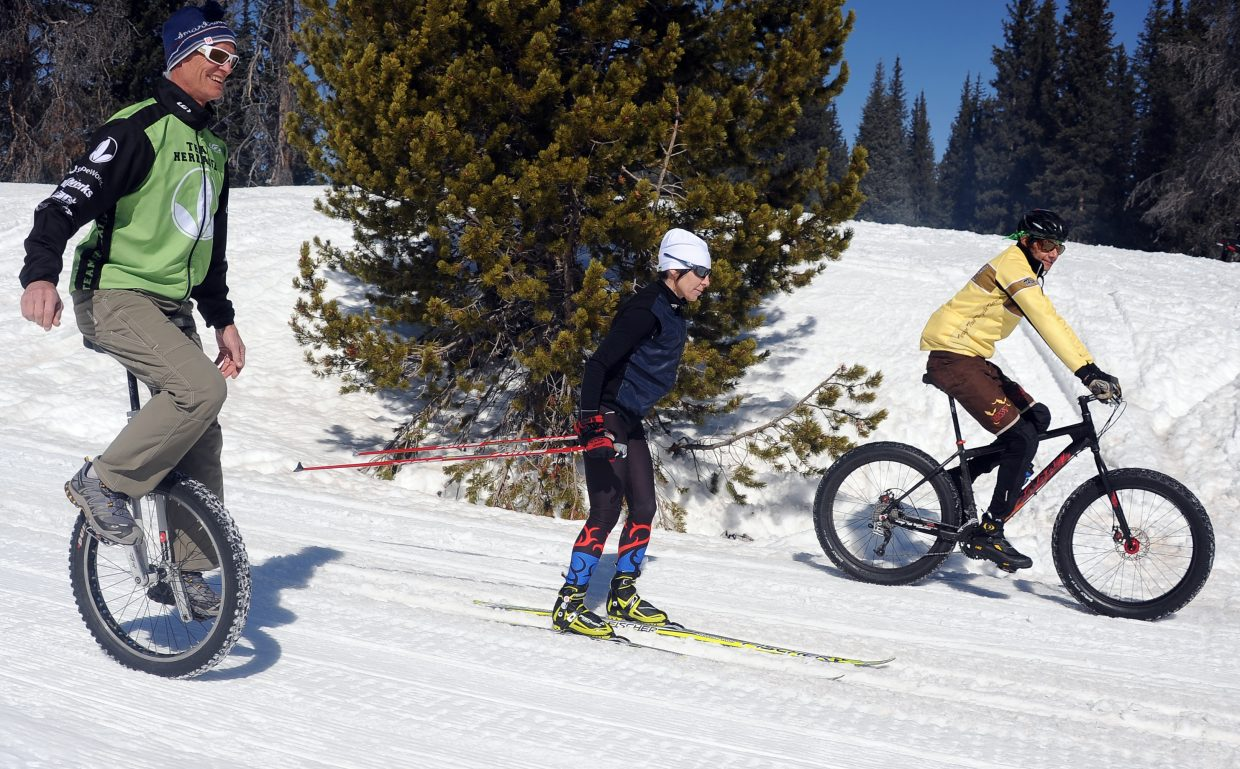 Dan Smilkstein, from left, Tammy Jacques and Essam Welch demonstrate the combined methods of transportation that will be employed at next month's Steamboat Coureur on Rabbit Ears Pass.