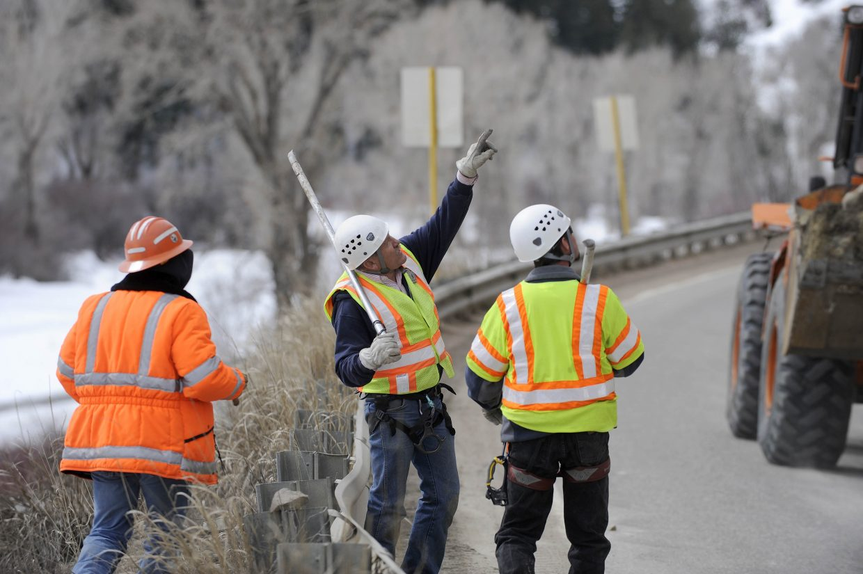 Colorado Department of Transportation workers assess a rock face threatening U.S. Highway 40 between Hayden and Steamboat Springs in 2011.
