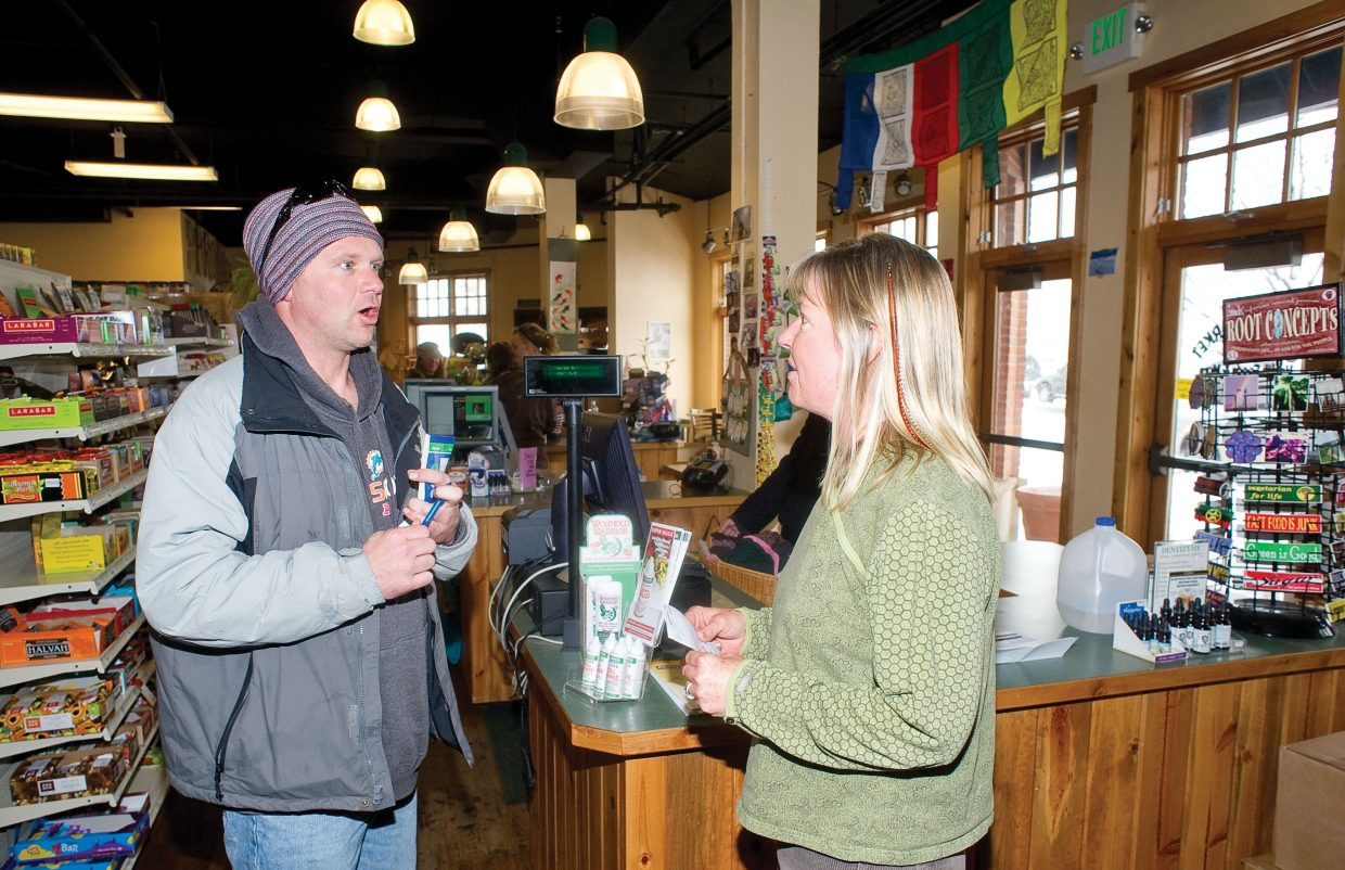 Vendor Isaac Barber and Bamboo Market owner Anne Halloran visit inside the store earlier this week. Bamboo Market offers shoppers natural choices and many products produced by local vendors like Barber.