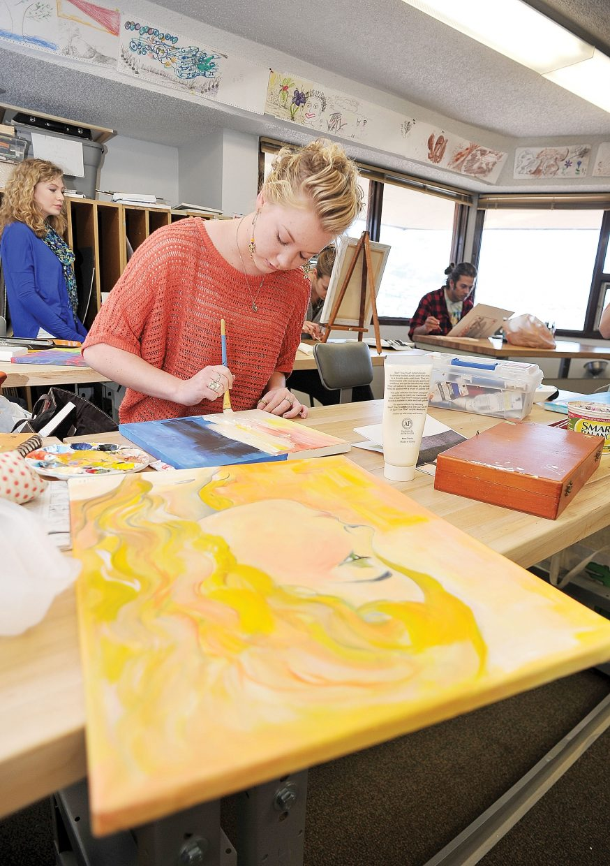 Colorado Mountain College student Sophie Myller works on a piece during art class Thursday.