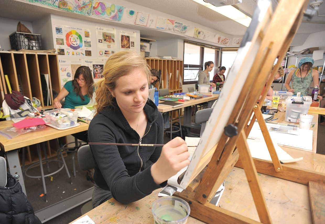 Colorado Mountain College student Liza Stout works on a piece during art class Thursday.