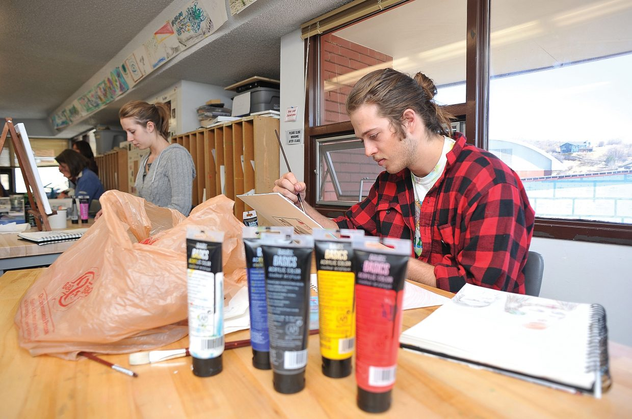Colorado Mountain College student Jeremy Justus works on a piece during art class Thursday.