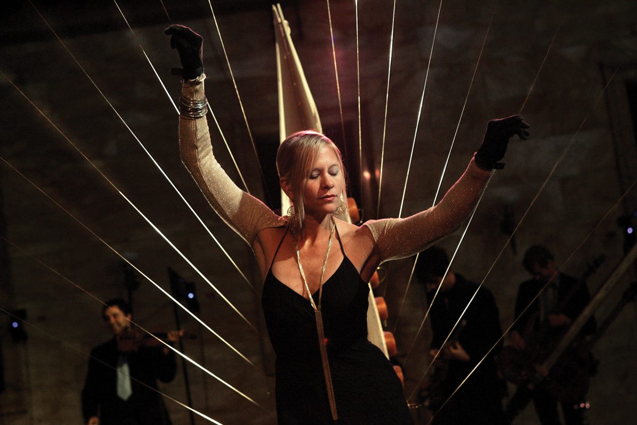 The MASS Ensemble combines music, sculpture and movement in an eclectic act that includes innovative instruments like the Earth Harp, shown here. The group opens Strings Music Festival's Different Tempo series June 30.