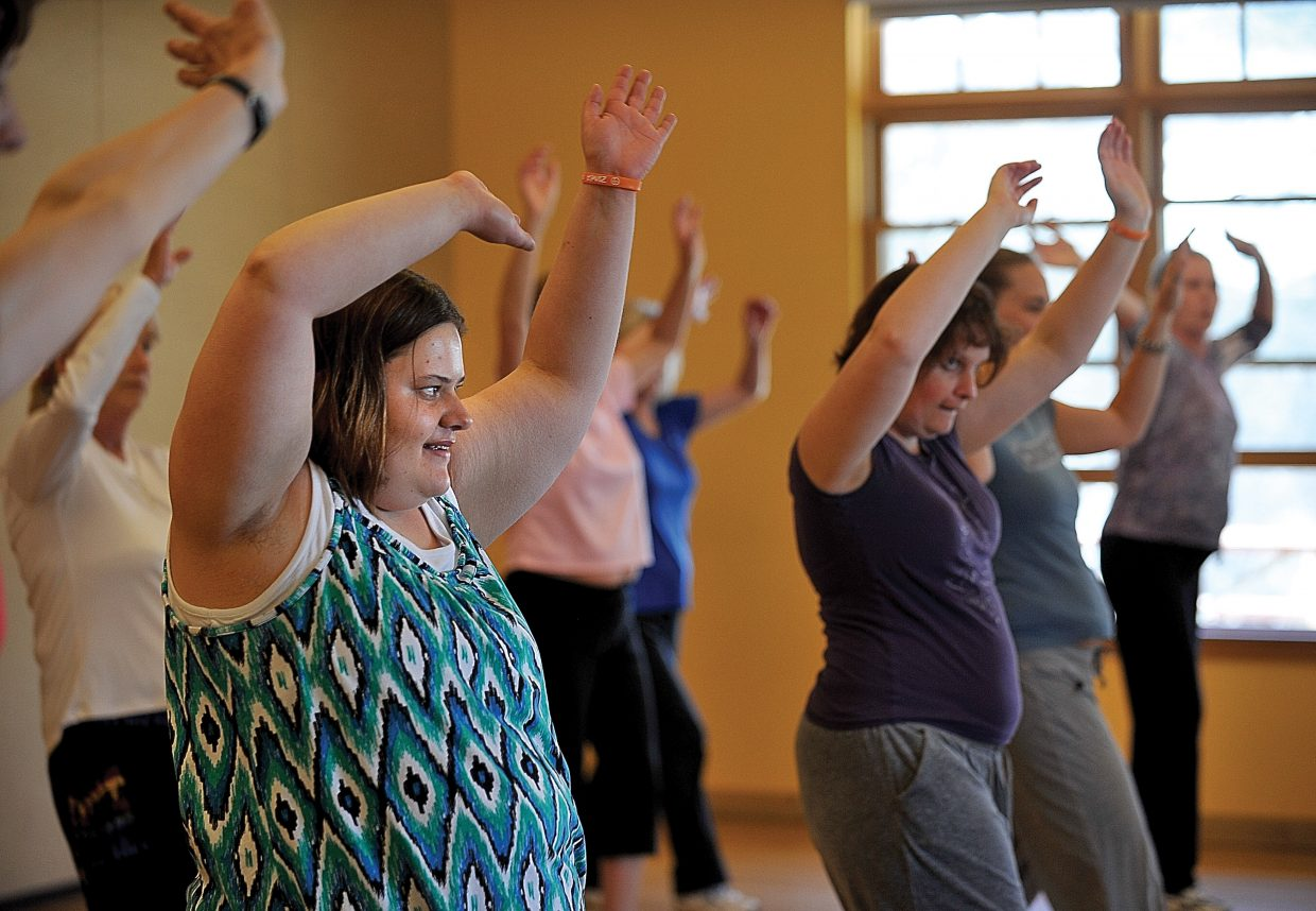 Jamiee Sexton participates in a Zumba class at the Steamboat Springs Community Center on Friday morning. Horizons clients are regulars in many community activities helping clients blend in and become an important part of the community where they live.