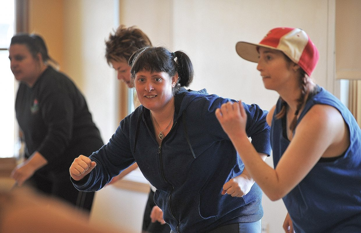 Jamie Kaminski participates in a Zumba class at the Steamboat Springs Community Center on Friday morning. Horizons clients are regulars in many community activities helping clients blend in and become an important part of the community where they live.