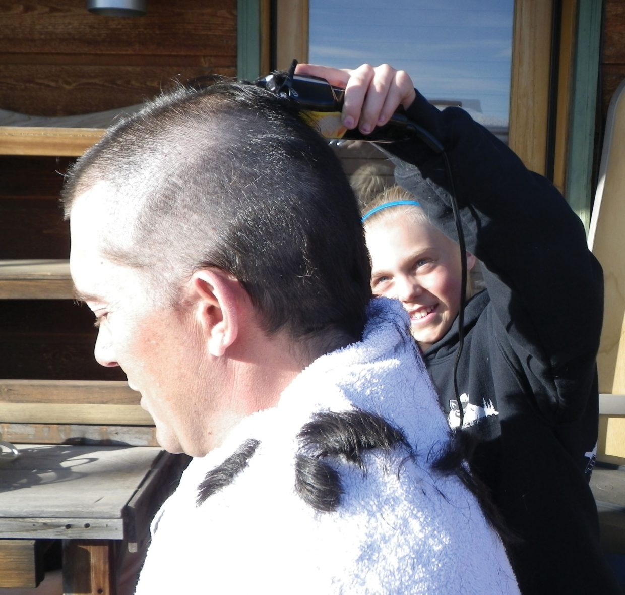 Ski coach Chris Puckett gets a new hairdo courtesy of Riley Smith. Puckett offered to let his athletes shave his head if they won a race at the J5 Rocky Mountain Division Finale on March 11 in Powderhorn. Riley won the slalom race and got her shot with the trimmers.