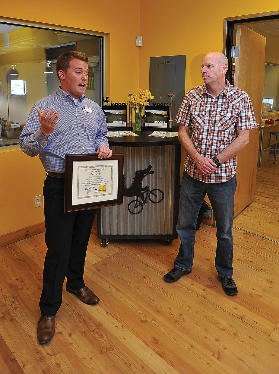 Sam Bailey, from the governor's Office of Economic Development, presents Moots President Rob Mitchell with a plaque stating that the Steamboat Springs business ranks among Colorado's Top 50 Companies to Watch.