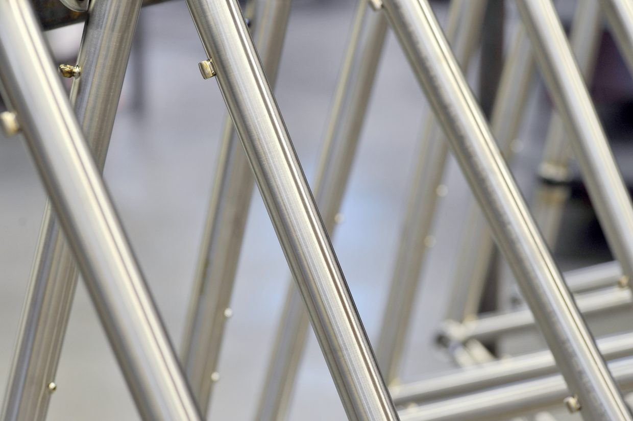 Titanium frames line up inside the Moots bicycle factory in Steamboat Springs.