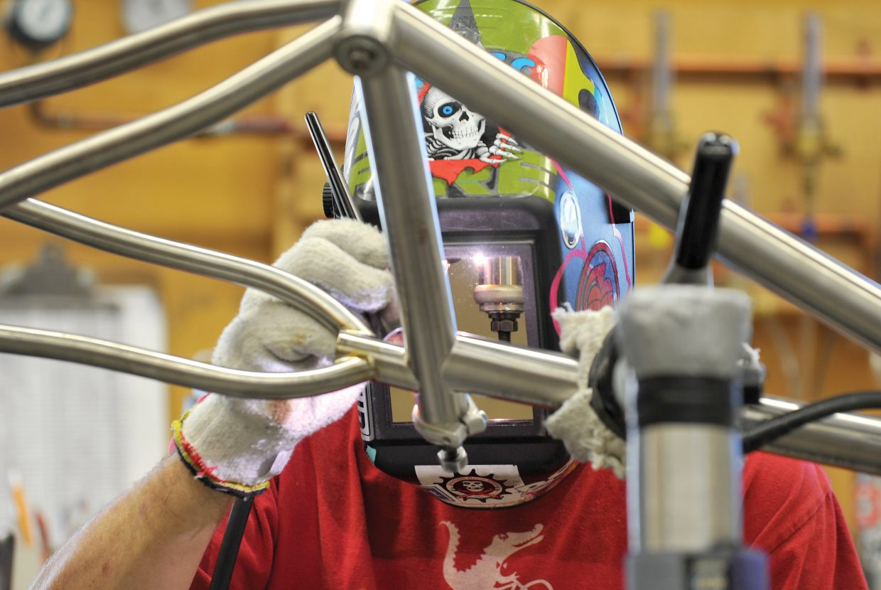 Welder Caleb Franklin works on a bicycle frame at the Moots bike factory in Steamboat Springs. The company ranks among Colorado's Top 50 Companies to Watch.