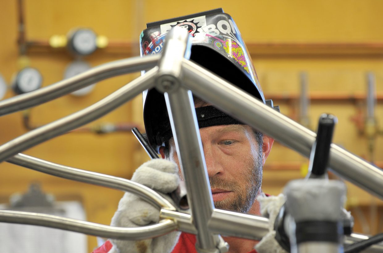 Welder Caleb Franklin works on a bicycle frame at the Moots bicycle factory in Steamboat Springs. The company ranks among Colorado's Top 50 Companies to Watch.