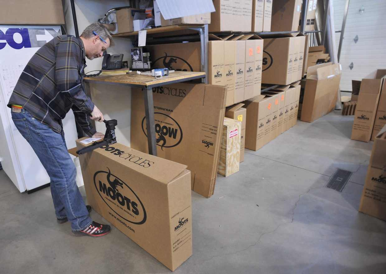 Moots' Matt Alford packs another bike for shipping at the Steamboat Springs-based company.