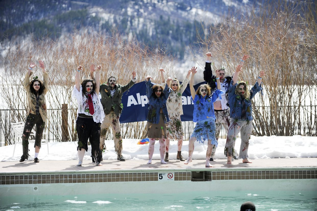 Yampa Valley Bank team members perform during the ninth annual Penguin Plunge on Saturday at Catamount Ranch & Club.
