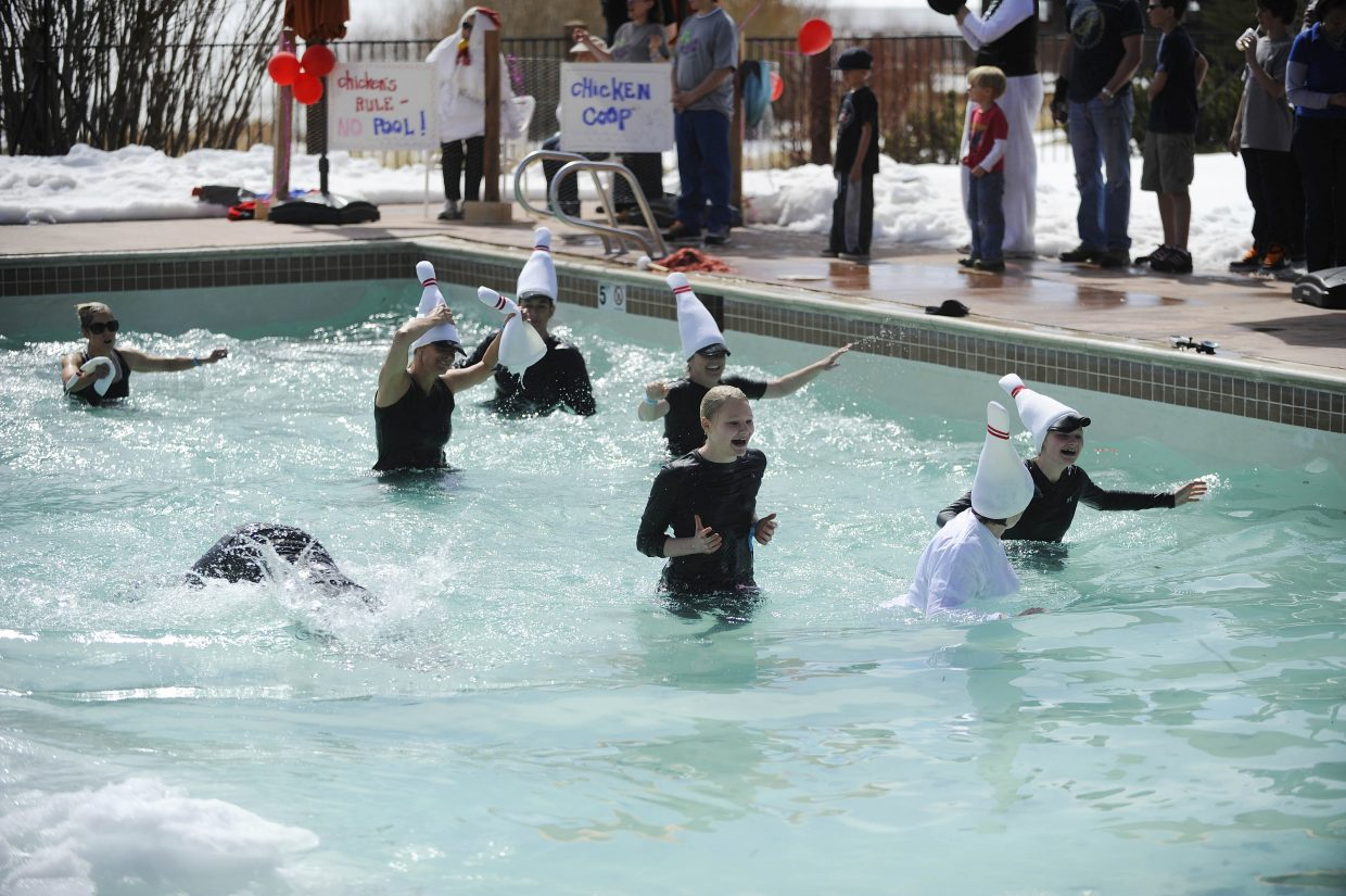 Yampa Valley Medical Center team members wade through the near-freezing waters during the ninth annual Penguin Plunge on Saturday at Catamount Ranch & Club.