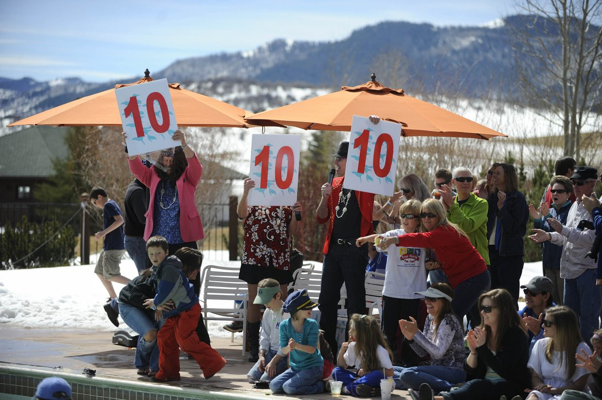 Judges give their scores during the ninth annual Penguin Plunge on Saturday at Catamount Ranch & Club.