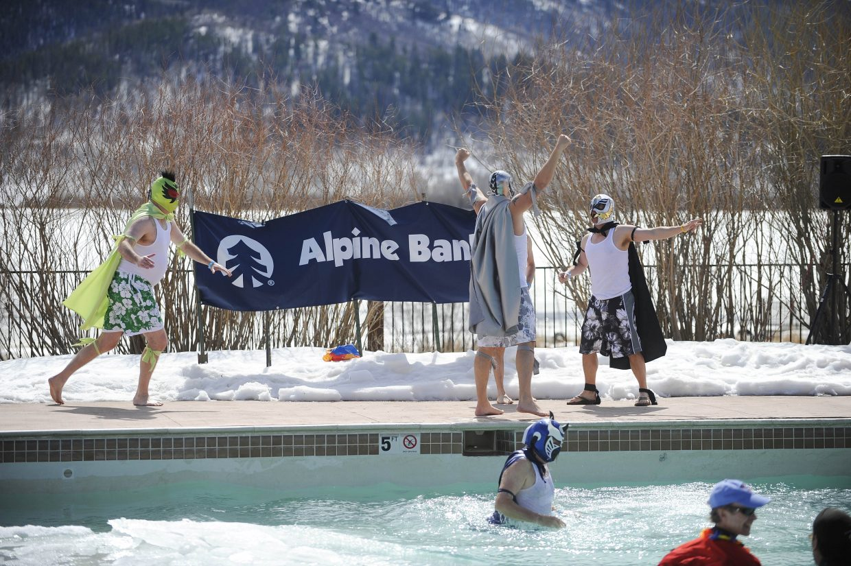 Ski Town USA Rotary Club members perform during the ninth annual Penguin Plunge on Saturday at Catamount Ranch & Club.