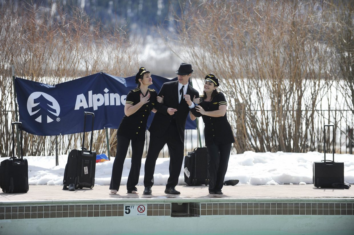 Rotary Club of Steamboat Springs team members perform during the ninth annual Penguin Plunge on Saturday at Catamount Ranch & Club.