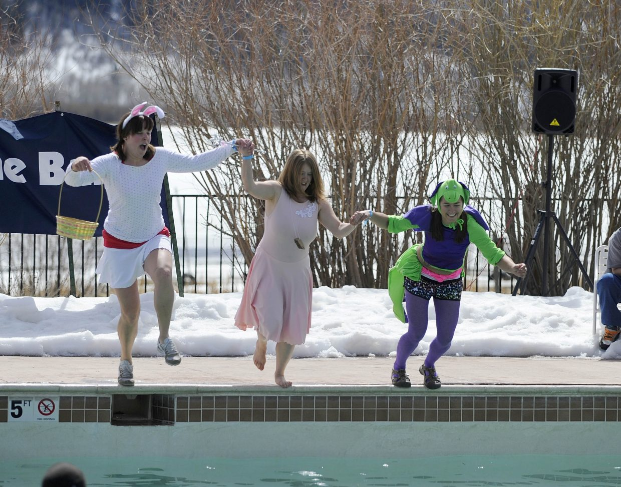 Young Professionals Network team members perform during the ninth annual Penguin Plunge on Saturday at Catamount Ranch & Club.