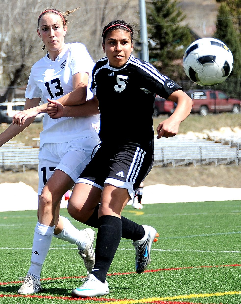 Eagle Valley's Blanca Mendez holds off Steamboat's Sydney Bauknecht on Saturday during a game in Steamboat. The Sailors won the matchup, 6-0.